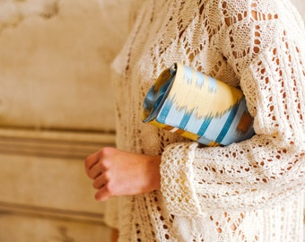 Ikat silk clutch hand made one of a kind blue and sand yellow color