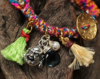 Woven cotton bracelet with sterling silver highlights and genuine gemstones