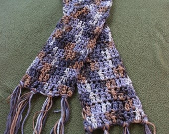 Scarf  crocheted from soft variegated yarn in shades of grey,tan, brown and ecru