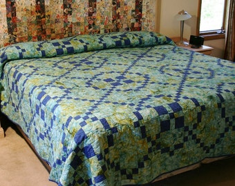 King quilt, Burgoyne Surrounded pattern, aqua and blue