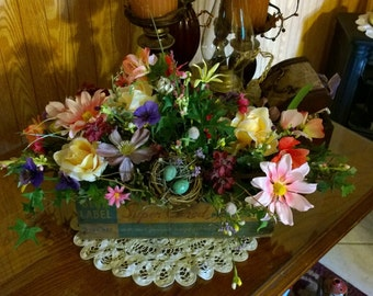 Garden flowers in chees box