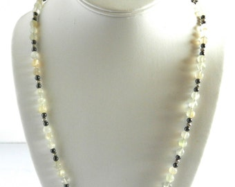 Moonshine  necklace,  handmade, knotted, moonstone,  hematite beads, silver tone for separators and clasp.