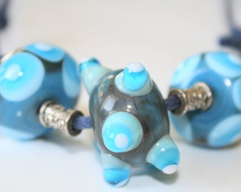 Blue lampwork necklace with melted and raised dots