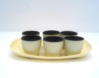 Set of six vintage 1950 Emsa egg cups on tray