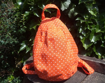 Orange polka dotted canvas backpack