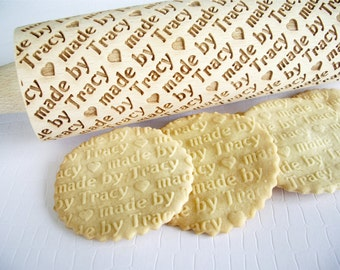 Personalized Rolling Pin - made by......  Lazer engraved rolling pin for homemade embossed cookies. Diagonally engraved text made by