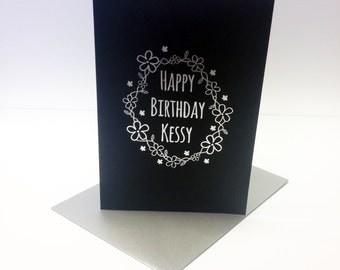 Personalised Birthday Card with custom name printed in metallic silver foil with a border of little flowers. Size A6.