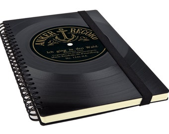 Recycling notebook made from old record