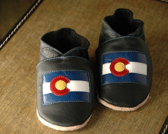 Wee·Kicks · Black & Colorado State Flag · Handcrafted Leather Footwear · Soft Sole Baby and Toddler Shoes ·