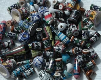 Hand painted clay ceramic beads x 100 mixed shapes, colours, sizes. Hand made and painted in Peru by artisans in Cuzco and fairtrade (bp599)
