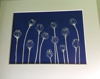 Original handpulled linocut print of poppy seed heads.