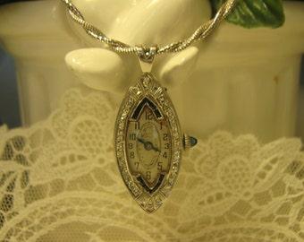 Antique Platinum diamond watch pendant. 11.1 grams.