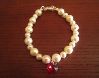 White swarovski Pearl bracelet with charm