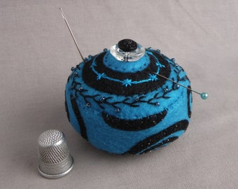 Handmade magnetic pincushion with embroidery, seed beads and vintage buttons.