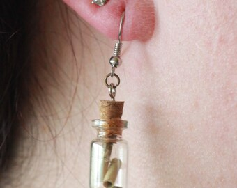 Bottled scroll dangles