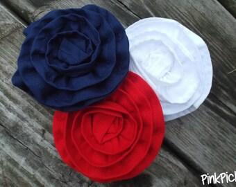 Rose Hair Clip Multi-pack Rosette Hair Clips red, white, and navy.