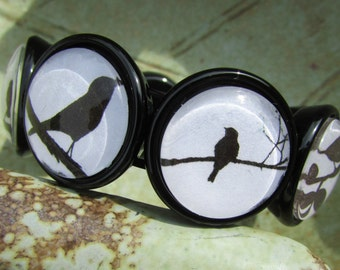 Bird Silhouette Bracelet with Alternating Images Under Polished Glass