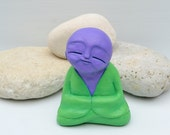 Purple and Green Monk sculpture - smiling - surreal - spiritual