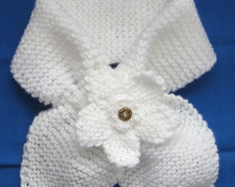 Scarf, Ladies Neck Warmer knitted with acrylic yarn decorated with a matching white flower with a glittery scrolled button in its center.