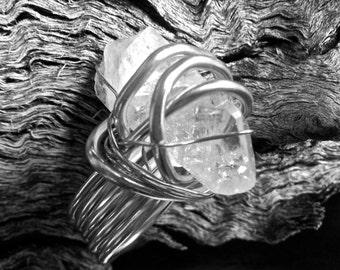Clear Quartz crystal Ring with Sterling Silver plated wire.