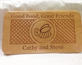 Personalized wood cutting board or bread board with carved design