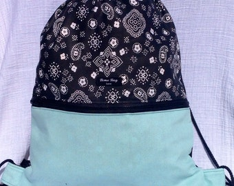 Teal black and white drawstring backpack