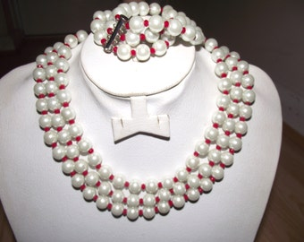A 3 row pearl choker with a matching bracelet