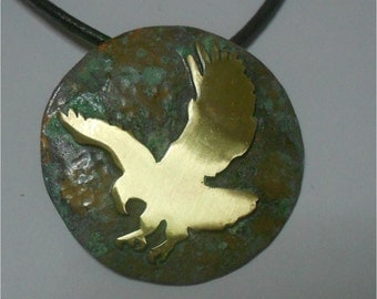 Pendant with brass oxidized - eagle over oxidized base