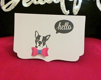 Dog with a bow tie saying 'hello'