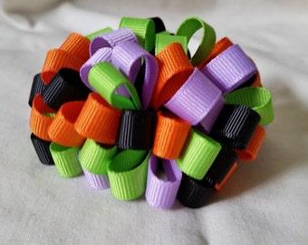 Halloween Loopy Puff Hair Bow in orange, green, and purple.