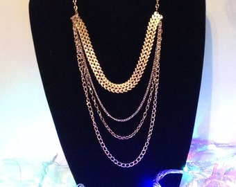Stylish Four layers of gold chain.