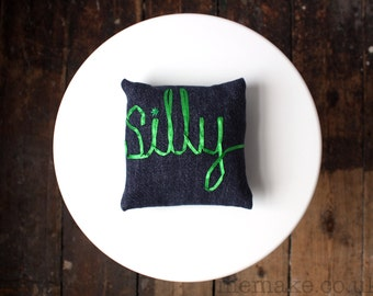 Small pillow with silly embroidered word decorative cushion navy denim green ribbon lettering typography memake handmade home decor