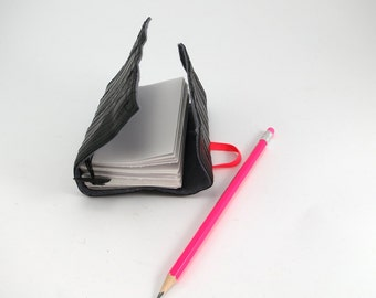 Recycled journal, bike inner tube, blank pages, grey linen and neon orange elastic closure, small.