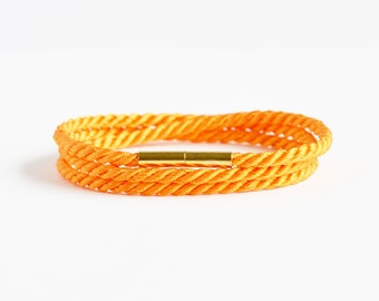 Neon orange triple wrap rope bracelet with gold magnetic clasp