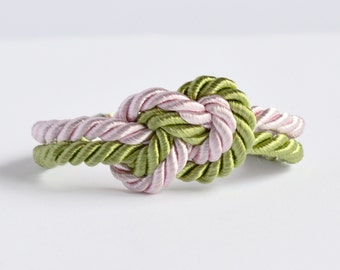 Light pink and dark lime green infinity knot nautical rope bracelet with silver anchor charm