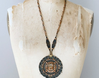 Vintage Mexican copper and brass modernist necklace / 1960s Aztec face medallion statement necklace Mexico