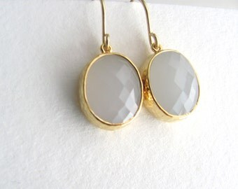 Ice oval drop earrings, faceted glass in gold frames on 14k gold plated fixtures, ice white, light gray