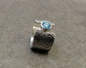 London Blue Topaz sterling silver ring with paisley pattern impression textured band