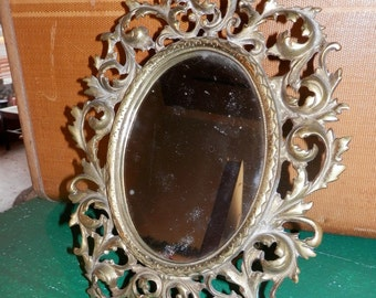 vintage fancy cast brass mirror for on top of the dresser