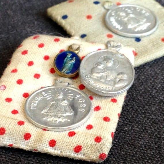 Precious pair of antique relics. Cute religious souvenir medals.