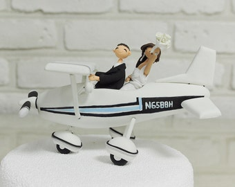 Cute couple on the plane wedding cake topper