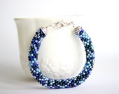 Beaded bracelet in shades of blue. Blue rope bangle. Beaded tube bracelet. Pixel jewelry. Random pattern bracelet. Blue bangle