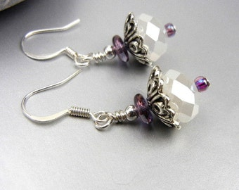 Milky white crystal earrings with silver caps and purple bead accents