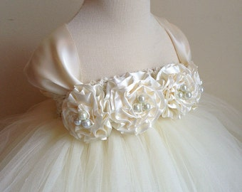 Ivory flower girl dress with ivory hand rolled flowers. Tutu dress