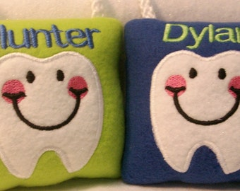 Personalized tooth fairy pillow comes with a free I Lost My Tooth button