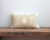Aya Contour lumbar pillow cover hand printed in metallic gold on white organic hemp cotton