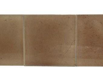 Set of beige square ceramic tiles