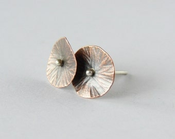 Small flower studs in copper and silver. Delicate romantic earrings.