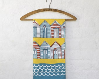 Beach Huts coastal tea towel - designed by Jessica Hogarth Designs and printed in the UK. Colourful kitchen textiles, cotton tea towel