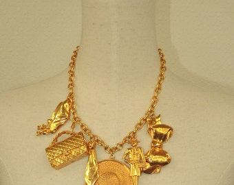 Vintage CHANEL gold tone chain necklace with large motifs, 2.55 bag, mademoiselle, shoes, tie, hat and bow charms dangling pendant top.